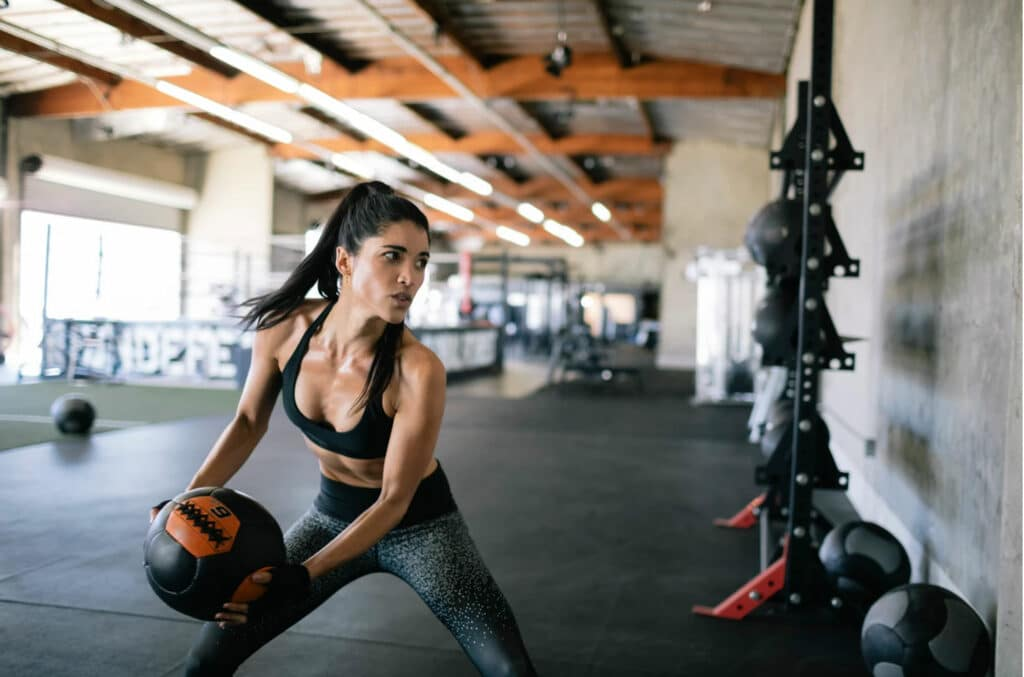 woman about to throw a medicine ball